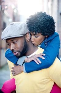 black-woman-kissing-man-on-neck-199x300